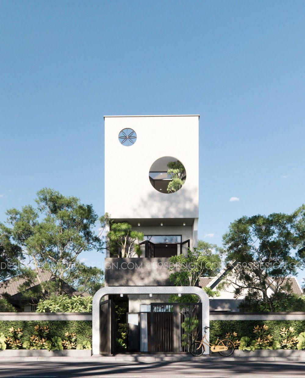 Cửa sổ hình tròn chính là điểm nhấn cho thiết kế mặt tiền nhà ở